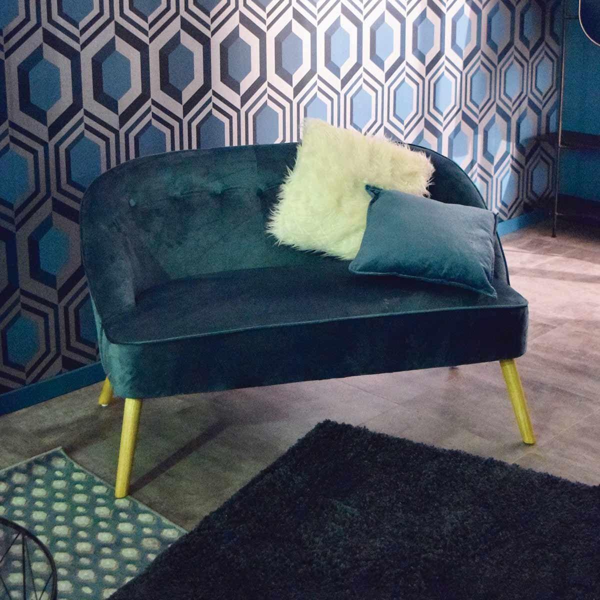 Canapé en velours bleu